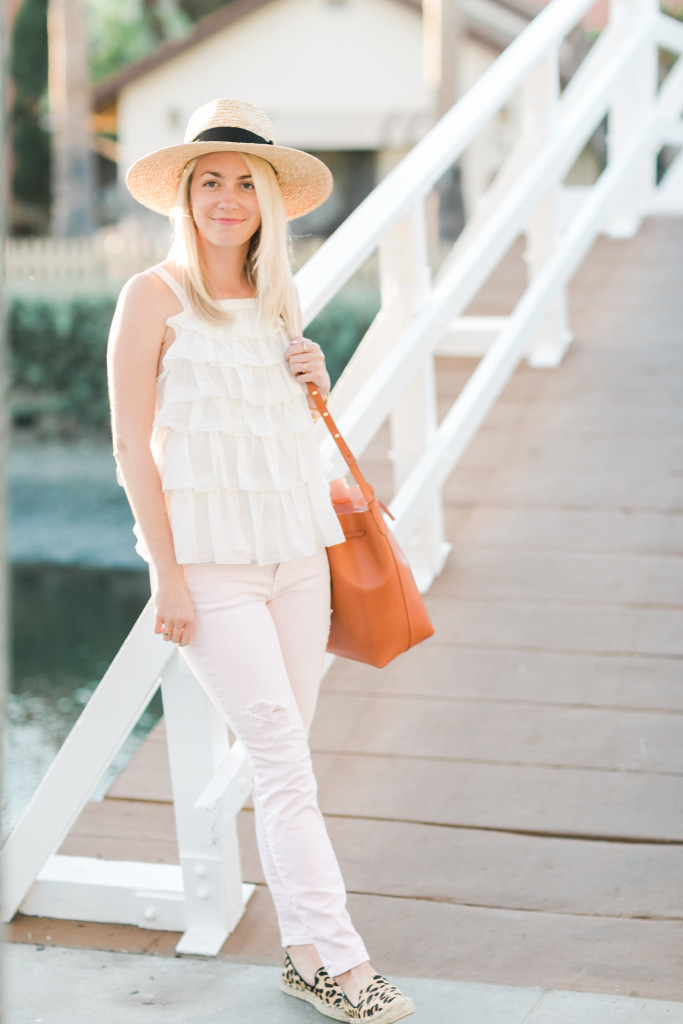 Joie Ruffle Top, Light Pink Distressed Jeans, Leopard Espadrilles, Mansur Gavriel Bucket Bag, and a Straw Sun Hat on Rhyme & Reason Fashion Blog
