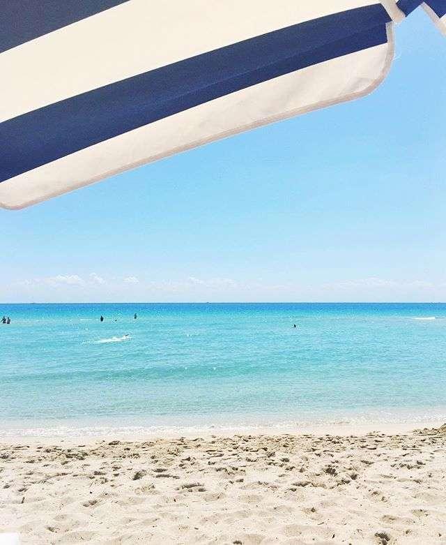 Blue and White Stripe Umbrella on Miami Beach on Rhyme & Reason Fashion Blog