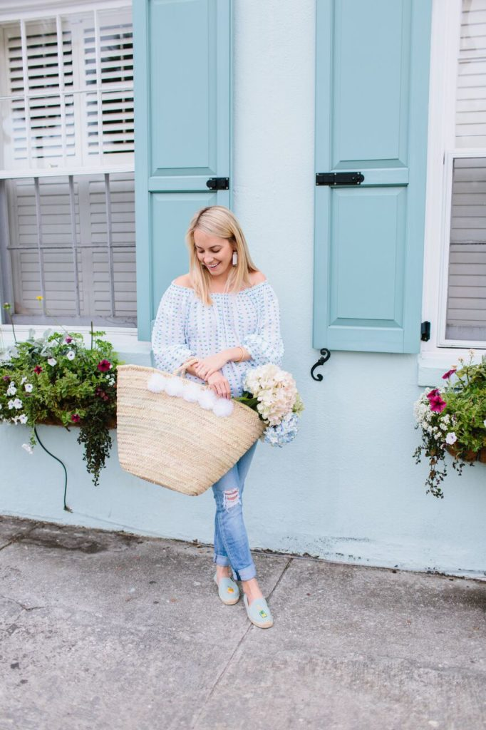 Jillian Attaway of Rhyme Reason Fashion Blog in Charleston in an Off the Shoulder top Eliza Gran Pom Pom Tote Distressed Denim and Soludos Espadrilles
