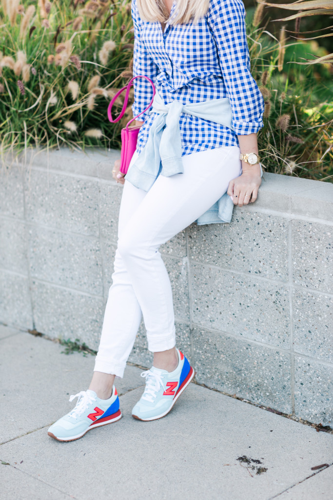 Playing Tourist In LA in a White Jeans, Gingham Top, New Balance Sneakers, Celine Sunglasses, and a Bright Pink Purse on Rhyme & Reason Fashion Blog