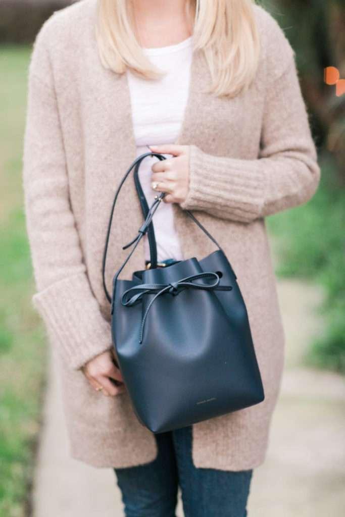 Cozy cardigan and navy mini bucket bag // Rhyme & Reason