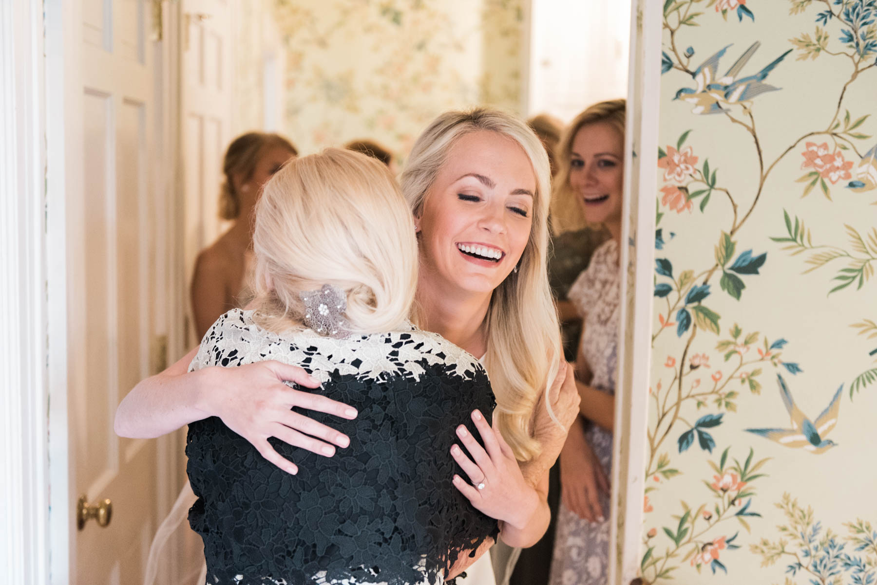 Southern bride, Jillian Attaway, hugs her new mother-in-law while getting ready on her wedding day // Rhyme & Reason