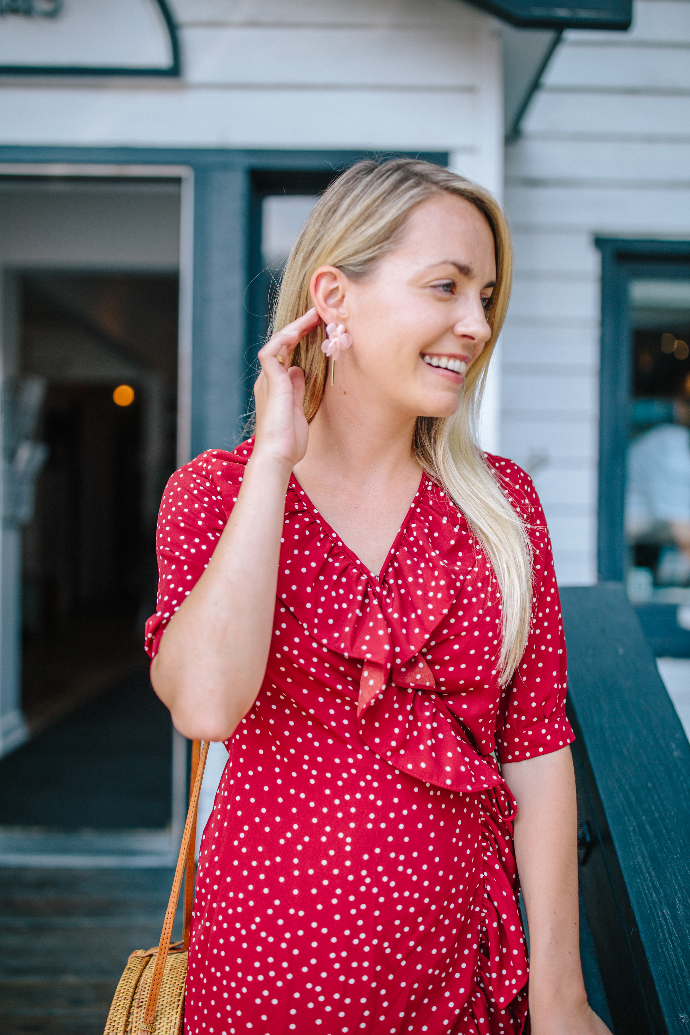 What to wear when transitioning your wardrobe from summer to fall: a red wrap dress that you can easily layer on top of // Rhyme & Reason