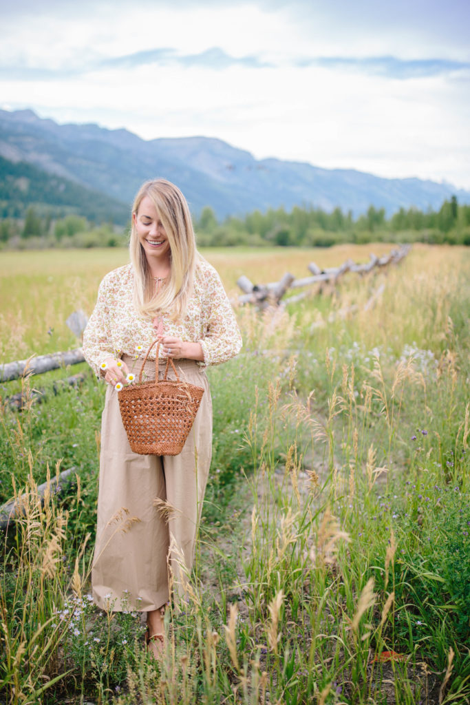 30 Places to Eat in Jackson Hole as told by a girl in a patterned shirt and beige pants