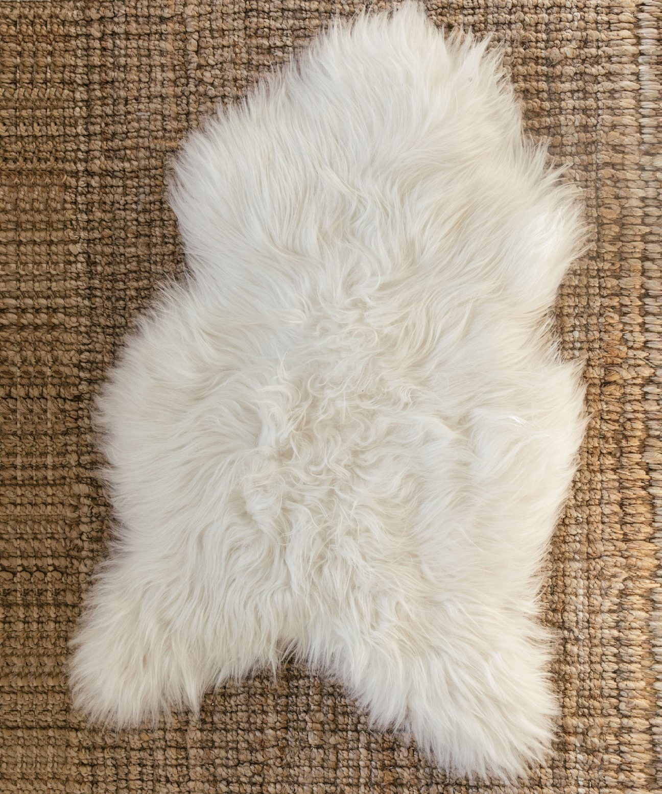 Gift Guide: Gifts for the Snow Bunny - Sheepskin Throw | Rhyme & Reason